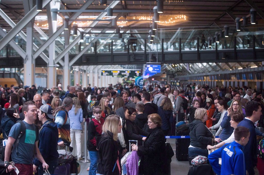 Passengers at Vancouver International Airport in Richmond, B.C., on Saturday, April 1, 2017