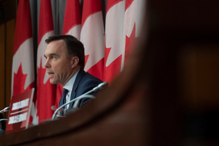 Finance Minister Bill Morneau speaks at a press conference in Ottawa in March 2020.